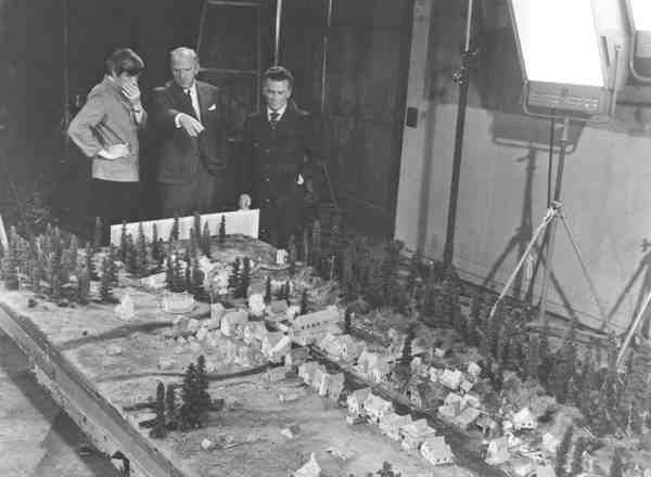 Producer Alan Jay Lerner, Director Joshua Logan and unidentified person overlooking the miniature set